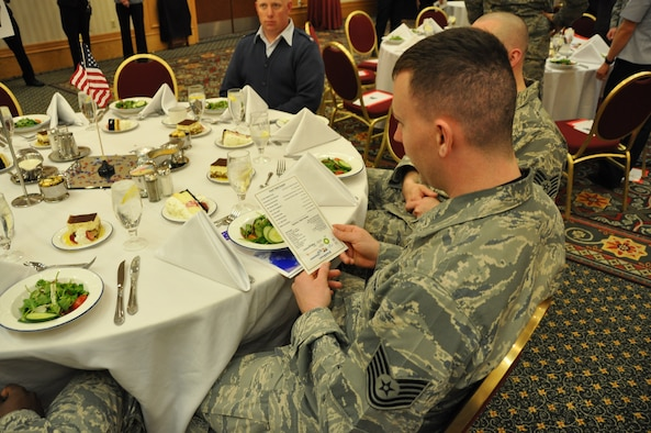 Tech. Sgt. Kevin Norris, 477th Force Support Squadron, reviews the agenda for the Anchorage Chamber of Commerce Military Appreciation lunch June 4. Lt. Gen. Stephen Hoog, commander of Alaskan Command, was this year's keynote speaker at the lunch held at the Anchorage Marriott Downtown Hotel. This event was the first of many during the Chamber of Commerce's19th Annual Military Appreciation week that will conclude with a Military Appreciation Picnic June 8.  (U.S. Air Force Photo/Capt. Ashley Conner)