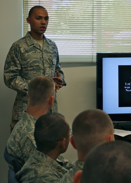 Tech. Sgt. Jewell, 13th Intelligence Squadron, speaks to Sacramento State Air Force ROTC cadets about the Air Force Code of Conduct May 2, 2012 at the university campus in Sacramento, Calif. The goal of the visit to the campus was to bring personnel outside of the Air Force ROTC cadre to help expand cadet?s knowledge. (U.S. Air Force courtesy photo. This image has been altered for operational security)