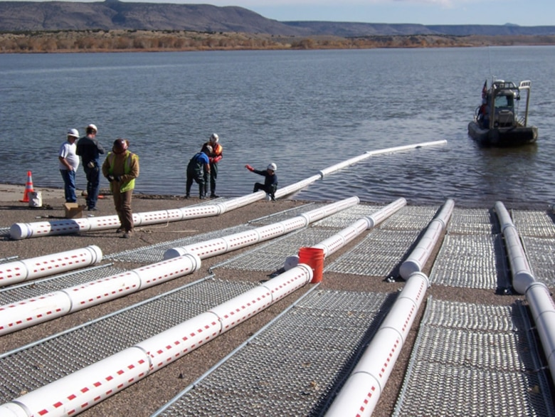 The Corps installed 50, 20-foot-long log booms in the canyon portion of Cochiti Lake, a half mile upstream of the Tetilla boat ramp, to catch debris.