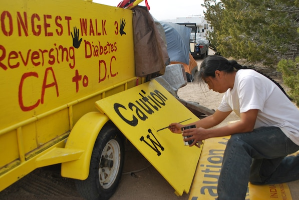 Navajo Artist Julius Badoni, a member of the Longest Walk team, creates a sign to be used on a truck accompanying walkers.