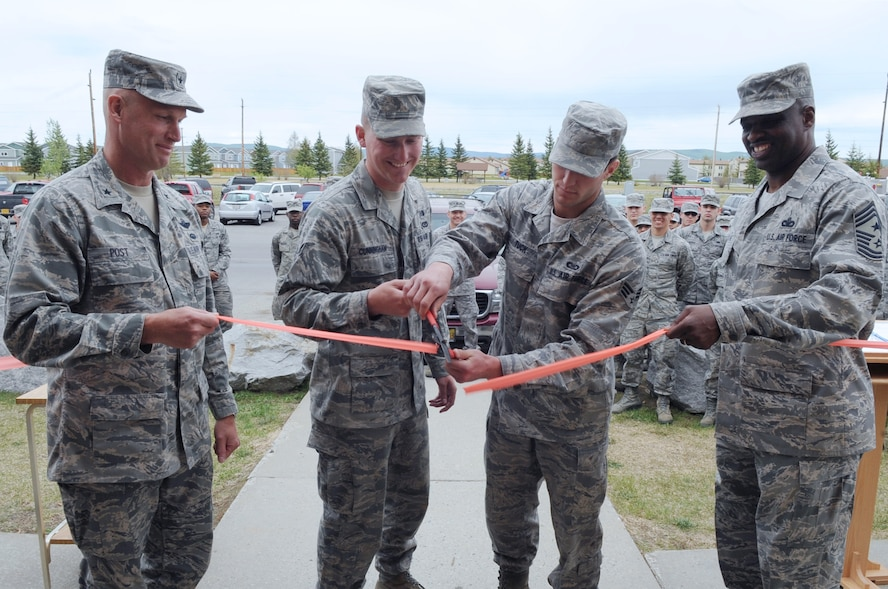 Brig. Gen. James Post, 354th Fighter Wing commander, Senior Airman Zachary