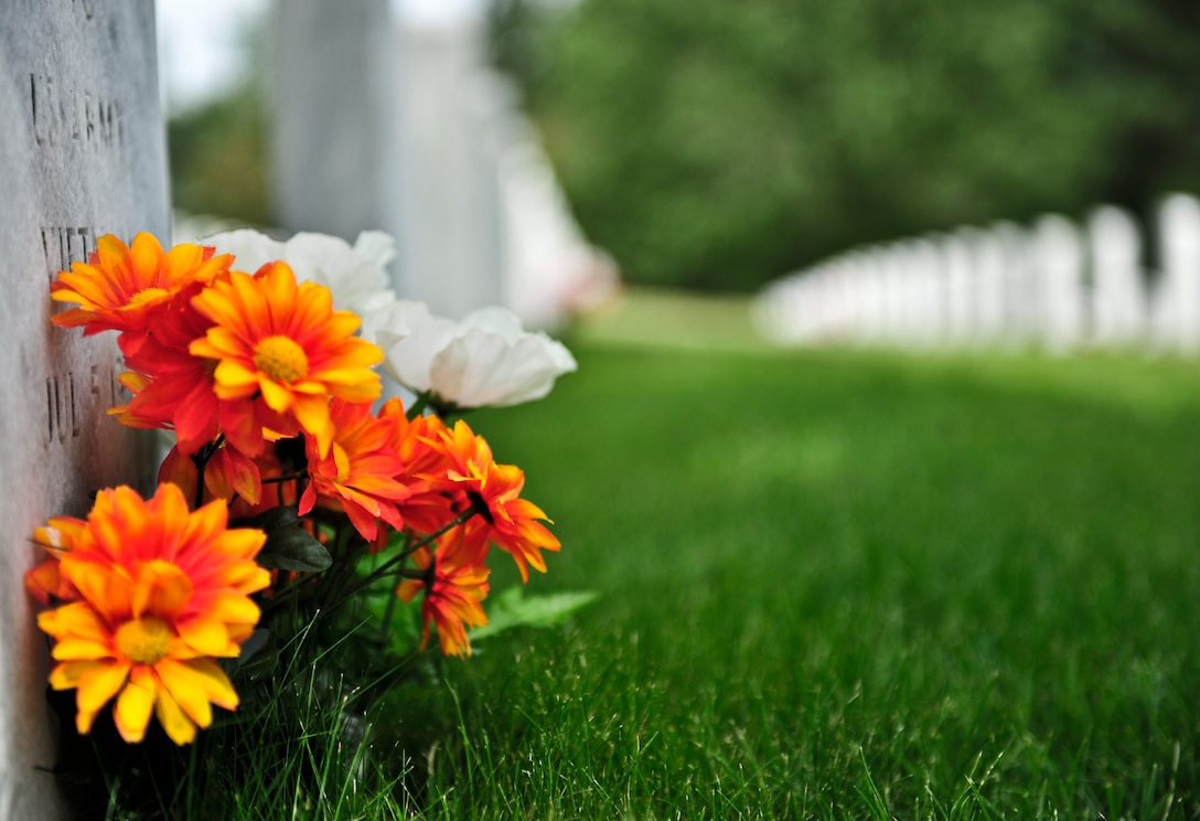 FORT LOGAN, Colo. -- A flower rest on the grave of the deceased at the Fort Logan National Cemetery June 5, 2012. Fort Logan is the resting place for Seven Buffalo Soldiers and is often used for rendering of military funeral honors. (U.S. Air Force photo by Senior Airman Paul Labbe)