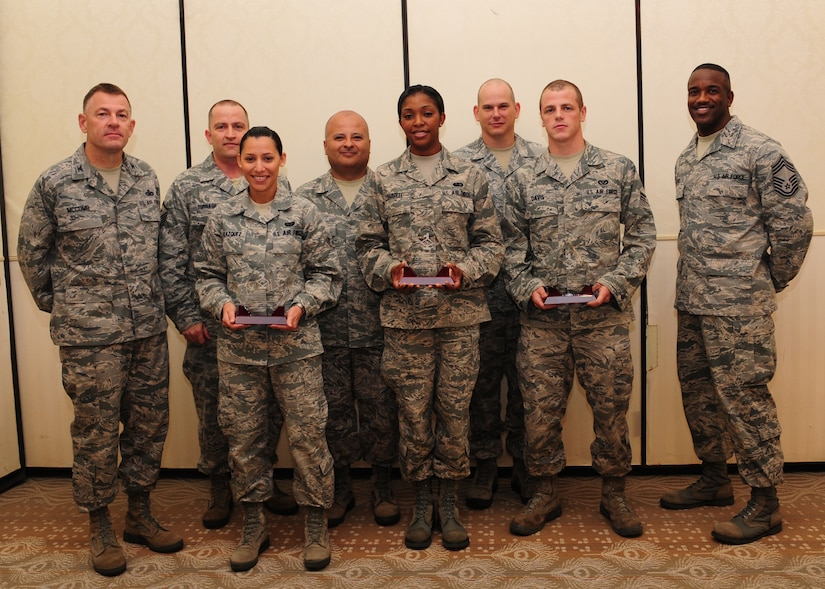 Colonel Richard McComb (left), Joint Base Charleston commander, and Chief Master Sgt. Avery Jones, 628th Mission Support Group superintendent (right), recognize June's Diamond Sharp winners at the Charleston Club at JB Charleston –Air Base, June 5. The Diamond Sharp recipients are (front row from left) Airman 1st Class Dariely Velazquez, 628th Communications Squadron, Airman 1st Class Kevonda Harrell 628th Force Support Squadron, and Airman 1st Class Kurt Davis, 628th Civil Engineer Squadron. Pictured with the Diamond Sharp winners are Master Sgt. David Turnage, 628th CS, Master Sgt. John Ward, 628 FSS and Master Sgt. Keith Bishop, 628th CE. Diamond Sharp awardees are Airmen chosen by their first sergeants for their excellent performance. (U.S. Air Force photo/Staff Sgt. Katie Gieratz)