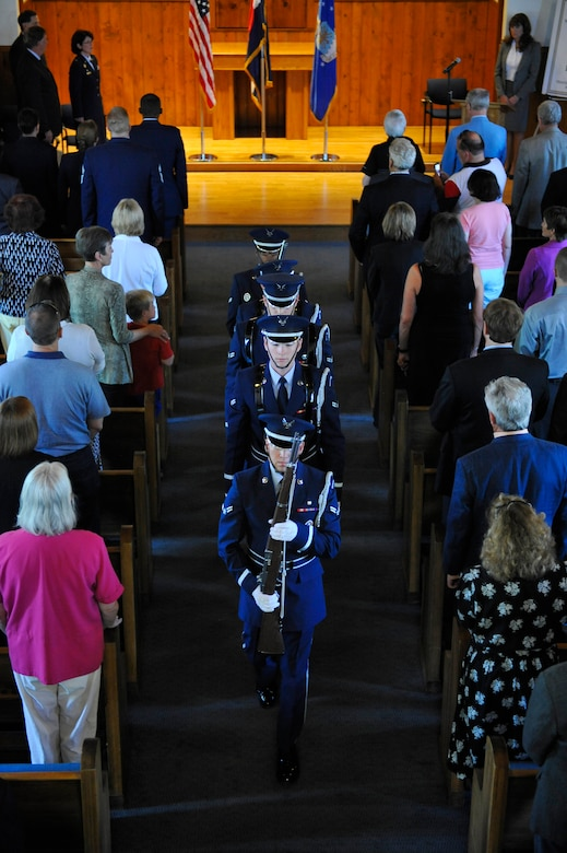 DENVER, Colo. -- Team Buckley honor guardsmen carry the colors to the stage of Eisenhower Chapel May 31, 2012. The chapel was part of the former Buckley Annex, the last parcel of land of Lowry AFB to be turned over to Denver. (U.S. Air Force photo by Staff Sgt. Kathrine McDowell)