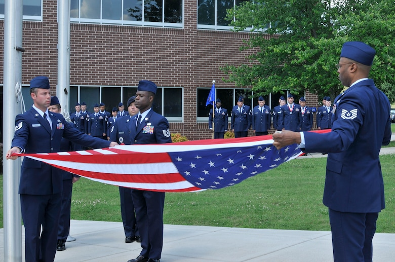 McGHEE TYSON AIR NATIONAL GUARD BASE, Tenn. - The students of Airman Leadership School Class 12-4 and Noncommissioned Officer Academy Class 12-5 perform a retreat ceremony on the campus of the I.G. Brown Training and Education Center following their graduation ceremony, June 7, 2012. (National Guard photo by Master Sgt. Kurt Skoglund/Released)