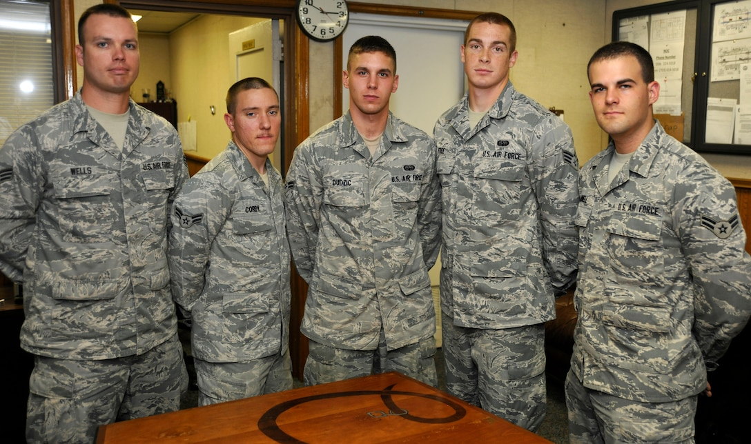 Members of the 744th Communications Squadron's Airman Motivation Program (AMP) pose for a photo May 9 inside Building 1539 here. AMP encourages Andrews' base populous to seek self improvement through activities that foster teamwork, physical fitness and unit camaraderie. (U.S. Air Force photo/Senior Airman Lindsey A. Porter)