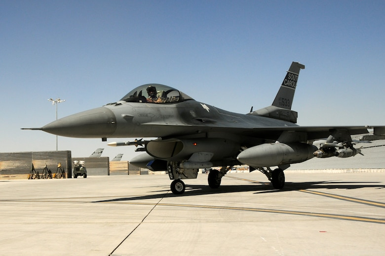 Lieutenant Colonel Scott Bridgers, a fighter pilot assigned to the 157th Expeditionary Fighter Squadron at Kandahar Airfield, Afghanistan, taxis an F-16 Fighting Falcon onto the flight line after flying a mission and reaching his 4,000th flying hour June 2, 2012. Lt. Col. Bridgers is the third fighter pilot to have achieved that level of flying from McEntire Joint National Guard Base, S.C.. Swamp Fox F-16's, pilots, and support personnel began their Air Expeditionary Force deployment early April to take over flying missions for the air tasking order and provide close air support for troops on the ground in Afghanistan in support of Operation Enduring Freedom. (U.S. Air Force photo/TSgt. Caycee Cook)