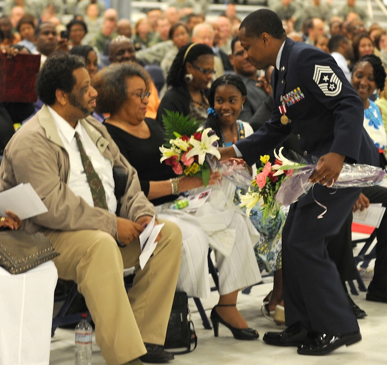 Chief Master Sgt. Anthony Brinkley, 11th Wing/Joint Base Andrews command chief, presents his mother with a bouquet of flowers during his retirement ceremony June 8, 2012. Brinkley served more than 28 years in the Air Force.  (U.S. Air Force Photo by Staff Sgt. Torey Griffith)