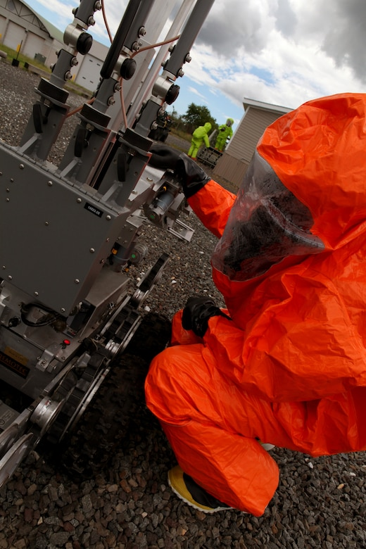 Tech. Sgt. David Niedzwiadek, Explosive Ordnance Disposal (EOD) technician checks an ANDROS F6A Explosive Ordnance Disposal robot during an exercise at the 177th Fighter Wing June 6, 2012. Airmen from the 177th along with New Jersey National Guard Soldiers and Airmen of the 21st Civil Support Team (Weapons of Mass Destruction), South Jersey Transit Authority firefighters and New Jersey State Police responded to a simulated weapons of mass destruction incident.  Members of the 177th Explosive Ordnance Disposal team worked with the 21st CST in reacting to a simulated explosion on base. The 21st CST supports civil authorities by responding to a weapons of mass destruction (WMD) situation. The unit is made up of full-time New Jersey Army and Air National Guard members that have been trained and equipped to provide support to civil authorities at a domestic chemical, biological, radiological, nuclear and high-explosive (CBRNE) incident site by identifying CBRNE agents/substances, assessing current and projected consequences and advising on response measures and assisting with appropriate requests for state support.  U.S. Air Force photo by Master Sgt. Mark C. Olsen