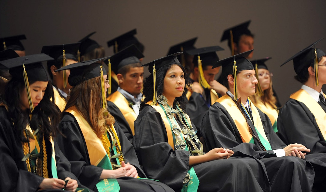 """Edgren High School graduates listen to words of encouragement during their graduation ceremony at the Misawa Civic Center in Misawa City, Japan, June 8, 2012. This year's graduating class motto is """"The world isn't ending, we're just taking over."""" (U.S. Air Force photo by Airman Kenna Jackson/Released)"""