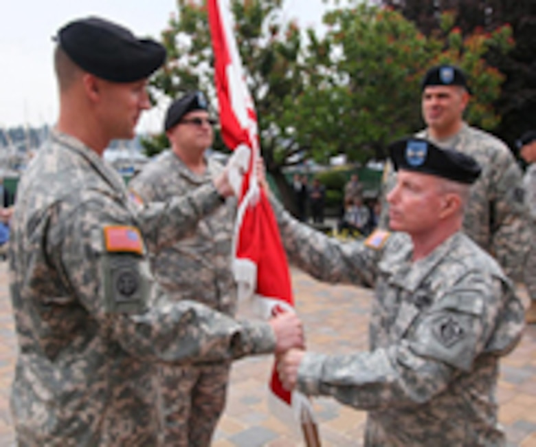 "Wehr accepted the Division guidon from the Deputy Commander of the Corps of Engineers, Maj. Gen. Merdith ""Bo"" Temple, during the symbolic passing of the colors."