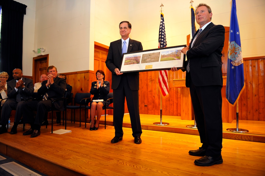 Denver and Air Force Personnel Center leaders watch as a lithograph is presented to Montgomery Force, right, by Stephen TerMaath in Denver on May 31, 2012. The presentation marked the turn-over of the Buckley Annex, the last 70 acres of the former Lowry Air Force Base, to the city of Denver. Force is the Lowry Redevelopment Authority executive director and TerMaath is the Base Realignment and Closure Program Management division chief. (U.S. Air Force photo/Staff Sgt. Kathrine McDowell)