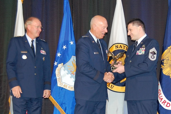 RENO, Nev. - Chief Master Sgt. William Yockell, human resource advisor for the Alaska Air National's 176 Wing, receives Human Resource Advisor of the Year Award from the Air National Guard Director Lt. Gen. Harry M. Wyatt and Gen. Craig R. McKinley, Chief National Guard Bureau at the 2012 Joint Diversity conference in Reno in May. National Guard photo.