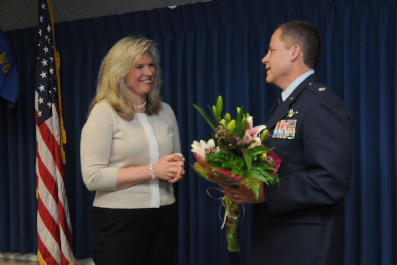 JOINT BASE ELMENDORF-RICHARDSON, Alaska - Lt. Col. Scott Coniglio shows his appreciation to his wife, Kerstin, for her support during his military career with an arrangement of flowers June 9, 2012. Lt. Col. Coniglio is the new commander of the 176 Maintenance Squadron. He will be in charge of more than 200 Airmen responsible for the maintenance of 176 Wing's fixed-wing aircraft and helicopters. National Guard Photo by Tech. Sgt. Jennifer Theulen.