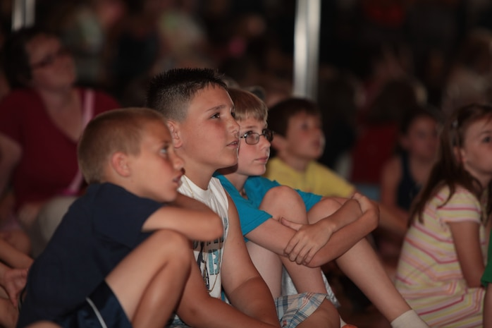 A crowd of children watch a puppet show during an educational outreach program put on by the National Museum of the Marine Corps at the John A. Polonye Community Center in Brook Park, Ohio, June 11. In addition to a puppet show about Marine Corps knowledge and traditions, children were introduced to Marine Corps uniforms worn throughout the ages. The event is scheduled to run Monday through Friday at 2 p.m. during Marine Week Cleveland, June 11-17.