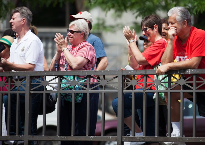 Members of the crowd applaud for the service of local residents during the Proclamation Ceremony for Marine Week Cleveland June 11, 2012. The ceremony marked the official beginning of events that will run from June 11-17. Cleveland Mayor Frank G. Jackson presented Lt. Gen. Steven A. Hummer, commander of Marine Forces Reserve and Marine Forces North, with the Marine Week proclamation and officially welcomed the Marines to the city. More than 750 Marines will be in Cleveland all week displaying Marine aircraft, vehicles and equipment, as well as interacting with and educating the public on the values and character of the Marine Corps. One of the culminating events will be a Marine Air Ground Task Force demonstration, which showcases Marines' ability to assault from ship-to-shore via ground and air, June 16-17 at Burke Lakefront Airport.