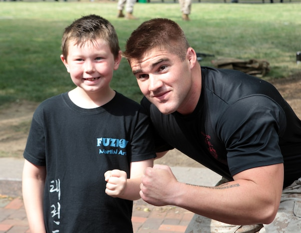 Peyton Buildt, 7, poses with Marine Corps Martial Arts Program instructor trainer Sgt. Daniel Leith, a Livonia, Mich., native, after a Marine Corps Martial Arts Program demonstration in Public Square June 12 during Marine Week Cleveland. Buildt, who came to the event with his aunt, studies martial arts and said he was impressed to see how high the Marines kicked. Marine Week Cleveland is scheduled to continue through June 17.
