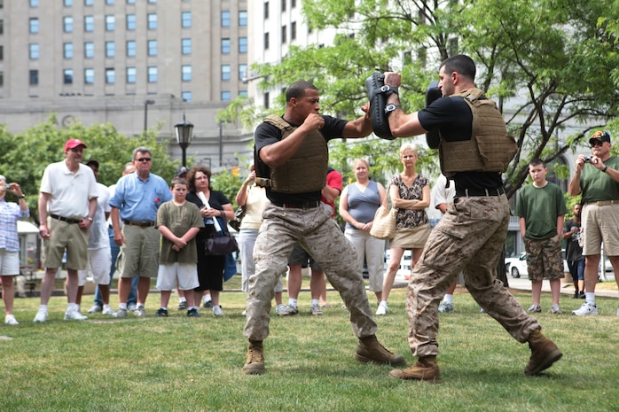 Staff Sgt. Shurron Thompson, left, and Staff Sgt. John Badon, right, both training instructors with the Marine Corps Martial Arts Program, demonstrate strikes and counters-to-strikes in a Marine Corps-style martial arts presentation, June 12 during Marine Week Cleveland. The daily presentations are scheduled to continue Wednesday through Friday at 10 a.m. and 3 p.m. during Marine Week. Marine Week Cleveland is scheduled to continue through June 17.