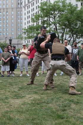 Crowd members gasped and responded with amazement to the fast-paced demonstration as Staff Sgt. John Badon, a Lufkin, Texas, native, and Sgt. Daniel Leith, a Livonia, Mich., native, both Marine Corps Martial Arts Program instructor trainers, demonstrate a variety of techniques June 12 during Marine Week Cleveland. Program demonstrations are scheduled to continue Wednesday through Friday at 10 a.m. and 3 p.m. during Marine Week. Marine Week Cleveland is scheduled to continue through June 17.