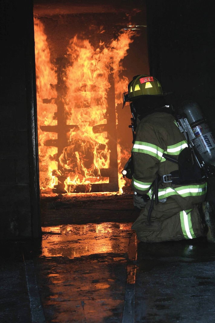 MARINE CORPS AIR STATION BEAUFORT, S.C. - Bob James, a firefighter with the Air Sation's Structural Fire and Emergency Services Department prepares the interior fire for the attack team and works as a safety officer during training.