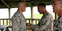 Captain Arlon D. Smith, an intelligence officer and Frankfort, Ind. native, was presented a Navy and Marine Corps Commendation Medal by Col. Christopher McCarthy, commanding officer at Marine Corps Security Cooperation Group during a formation at Joint Expeditionary Base Little Creek – Fort Story, Va., June12. During his tour at MCSCG, Smith deployed multiple times across three different continents, and lead teams in the training of partner forces.
