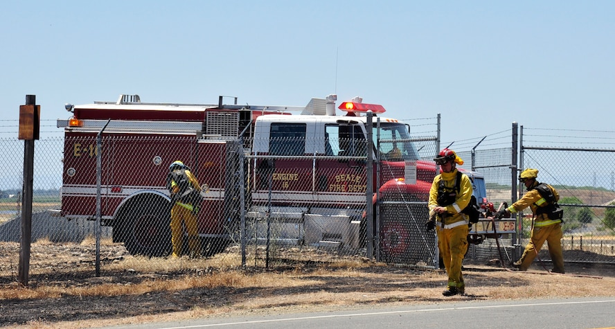 Members of Beale's Fire Department ready their truck to finish putting out a fire that burned near the Doolittle Gate at Beale Air Force Base, Calif., June 11, 2012. The fire consumed approximately 50 acres of grassland. (Courtesy photo by Noelle Hoffman)