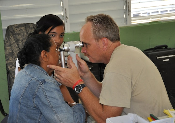 (Right) Maj. Steven Clough, 926th Aerospace Medicine Squadron optometrist, checks