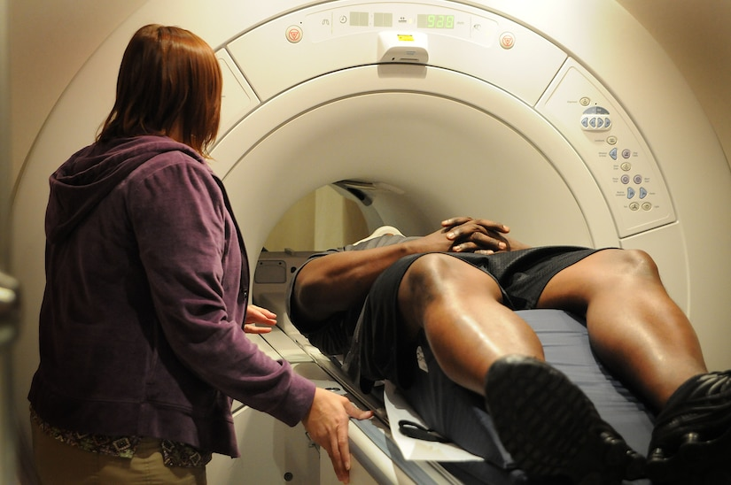 Magnetic Resonance Imaging Technologist Julie Walker explains the procedure to John L. Jackson ensuring he is ready for an exam of his cervical spine, the throat and neck area. The MRI technicians receive more than 70 requests for an MRI on a weekly basis. (U.S. Navy photo/Petty Officer 1st Class Jennifer Hudson)