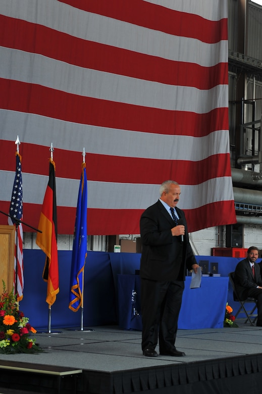 SPANGDAHLEM AIR BASE, Germany – Guest speaker, Michael Laue, BHS sports coordinator, speaks to Bitburg High School graduates about preparing and executing their goals and plans for their futures during their graduating ceremony inside Hangar 1 here June 9. The class of 2012 consisted of 54 students. More than 300 family members and guests attended the ceremony to celebrate the completion of their high school education. (U.S. Air Force photo by Airman 1st Class Dillon Davis/Released)