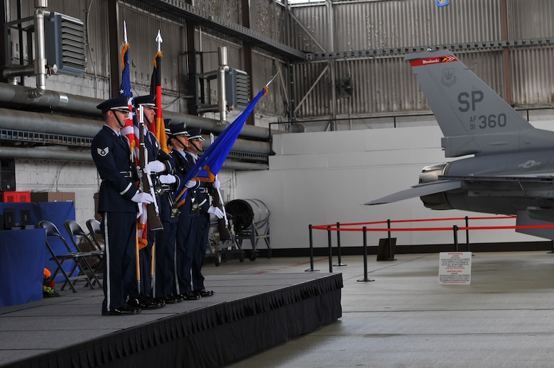 SPANGDAHLEM AIR BASE, Germany – Members of the 52nd Fighter Wing Honor Guard post the colors during the Bitburg High School graduation ceremony inside Hangar 1 here June 9. The class of 2012 consisted of 54 students. More than 300 family members and guests attended the ceremony to celebrate the completion of their high school education. (U.S. Air Force photo by Airman 1st Class Dillon Davis/Released)