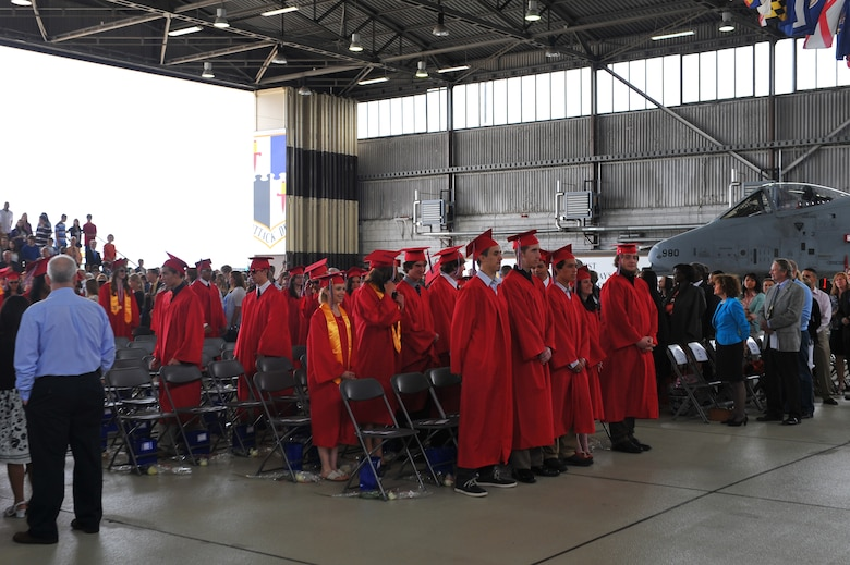 SPANGDAHLEM AIR BASE, Germany – Students of the Bitburg High School graduating class of 2012 file into their seats during the graduation ceremony inside Hangar 1 here June 9. The class of 2012 consisted of 54 students. More than 300 family members and guests attended the ceremony to celebrate the completion of their high school education. (U.S. Air Force photo by Airman 1st Class Dillon Davis/Released)