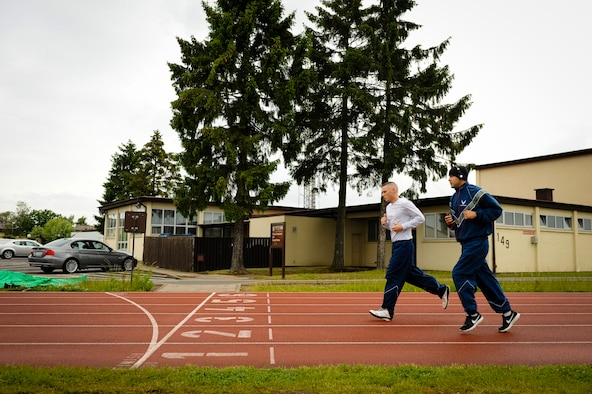 SPANGDAHLEM AIR BASE, Germany – Participants jog around the base track during a Wounded Warrior walk-a-thon here June 7. More than 230 people participated in the event, which raised funds for wounded warrior programs at Landstuhl Regional Medical Center. (U.S. Air Force photo by Staff Sgt. Nathanael Callon/Released)