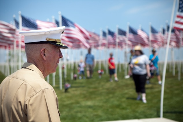 Lt. Gen. Steven A. Hummer, commander of Marine Forces Reserve and Marine Forces North, gazes upon American flags at Voinovich Park here June 12. More than 400 flags have been placed here as part of the static display in honor of Ohio service members. Voinovich Park is one of the sites of displays available for public during the Marine Week Cleveland. Along with the traveling Vietnam War Memorial Wall, Marine Corps vehicles, aircraft and equipment will be available for viewing at Public Square, Voinovich Park, Gateway Plaza and Rock and Roll Hall of Fame. Marine Week Cleveland celebrates community, country and the Corps. More than 750 Marines journeyed to Cleveland for the event, which runs through June 17. Ohio has more than 9,000 active and reserve Marines, making it one of the top-five producers of Marines.