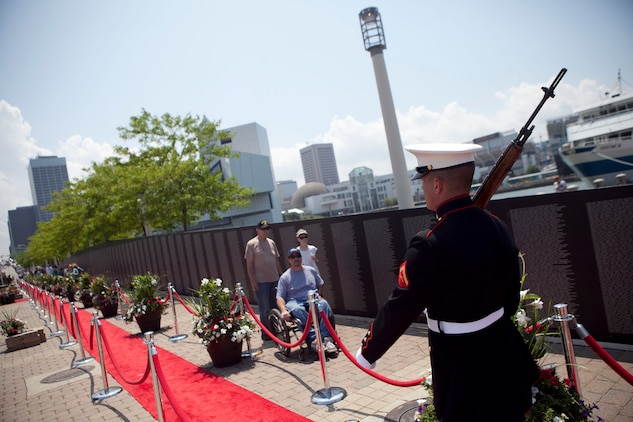 Lance Cpl. Robert Smith, a rifleman with 3rd Battalion, 25th Marine Regiment, and a native of Buffalo, N.Y., walks along the traveling Vietnam War Memorial Wall at Voinovich Park here June 12. Voinovich Park is one of the sites of displays available for public during the Marine Week Cleveland. Along with the wall, Marine Corps vehicles, aircraft and equipment will be available for viewing at Public Square, Voinovich Park, Gateway Plaza and Rock and Roll Hall of Fame. Marine Week Cleveland celebrates community, country and the Corps. More than 750 Marines journeyed to Cleveland for the event, which runs through June 17. Ohio has more than 9,000 active and reserve Marines, making it one of the top-five producers of Marines.