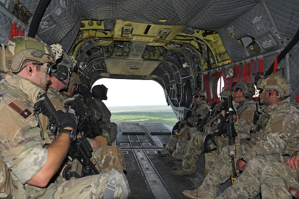 Members of the Texas Air National Guard's 147th Air Support Operations Squadron aboard a Texas Army National Guard CH-47 Chinook helicopter above Yankee Range, the norther of two ranges that comprise the McMullen Target Complex, which is part of Naval Air Station Kingsville, and is managed by Detachment 1, a subcomponent of the Texas Air National Guard's 149th Fighter Wing at Lackland Air Force Base, Texas, on May 30, 2012. (Air National Guard photo by Staff Sgt. Phil Fountain / Released)