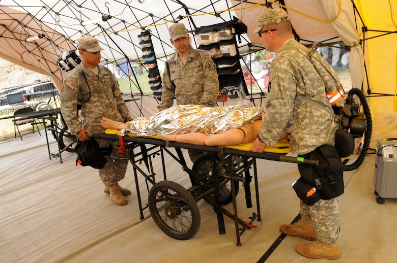Staff Sgt. John Gann, a Texas Air National Guard medic assigned to the 6 CBRNE Emergency Response Force Package (CERF-P), a subcomponent of Joint Task Force-71, coordinates medical activities with members of the Texas Army National Guard during an emergency preparedness exercise in Austin, Texas, on Apr. 26, 2012. (Air National Guard photo by Senior Master Sgt. Mike Arellano / Released)