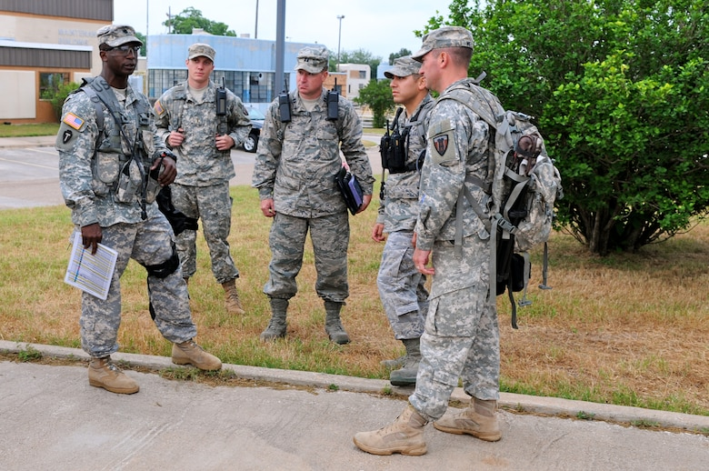 Army Lt. Col. Les Edwards (left), commander of the 6 CBRNE Emergency Response Force Package (CERF-P), a subcomponent of Joint Task Force-71, confers with members of the joint medical operations team during an emergency preparedness exercise in Austin, Texas, on Apr. 26, 2012. (Air National Guard photo by Senior Master Sgt. Mike Arellano / Released)