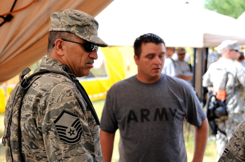 Master Sgt. Frank Rodriguez, a Texas Air National Guard medic assigned to the 6 CBRNE Emergency Response Force Package (CERF-P), a subcomponent of Joint Task Force-71, assists a member of the Texas Army National Guard who is playing to role of a chemical attack victim during an emergency preparedness exercise in Austin, Texas, on Apr. 26, 2012. (Air National Guard photo by Staff Sgt. Phil Fountain / Released)