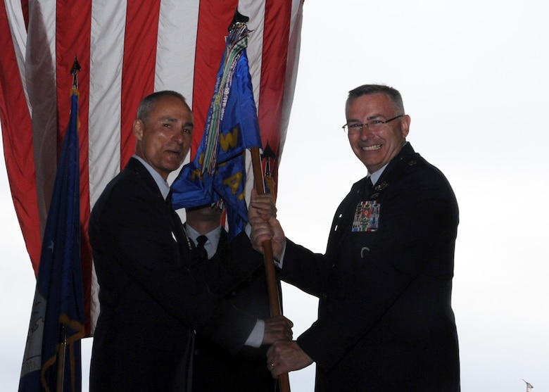 "ALTUS AIR FORCE BASE, Okla. – Brig. Gen. Udo K. ""Karl"" McGregor, commander of the 452nd Air Mobility Wing, March Air Reserve Base, Calif., passes the 730th Air Mobility Training Squadron guidon to Lt. Col.  Jonathan M. Philebaum, 730th AMTS commander, Altus AFB, during the squadron reactivation and assumption of command at hangar 517 June 13, 2012. The 730th AMTS falls under the 452nd Air Mobility Wing at March ARB and is part of the Air Force Reserve Command. (U.S. Air Force photo by Airman 1st Class Franklin R. Ramos / 97th Air Mobility Wing / Released)"