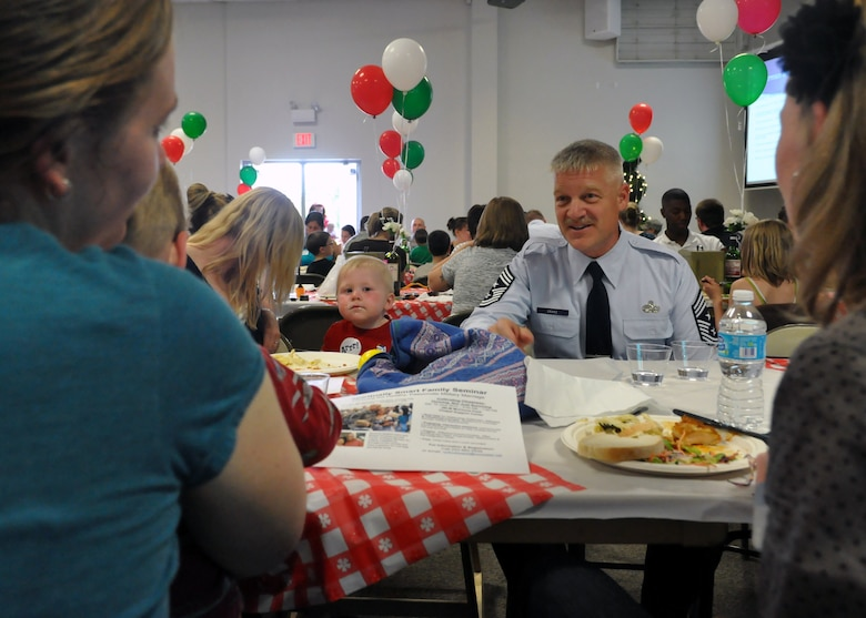 Chief Master Sgt. Gordon Drake, 62nd Airlift Wing command chief, speaks to a group of spouses at the quarterly Deployed Families Dinner June 11, 2012, at the McChord Field Chapel Support Center on Joint Base Lewis-McChord, Wash. Drake expressed his appreciation for hard-working spouses and emphasized the importance of a strong family. (U.S. Air Force photo/Senior Airman Leah Young)