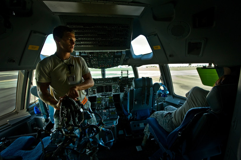 Senior Airman Benjamin Leis, an aircrew flight equipment technician with the 437th Operations Support Squadron out of Joint Base Charleston - Air Base, S.C., swaps out Quick Don oxygen masks on a C-17A Globemaster III, June 8, 2012. The Airmen swap out and inspect equipment for C-17A alert aircraft on standby every 30 days. (U.S. Air Force photo by Airman 1st Class George Goslin/Released)
