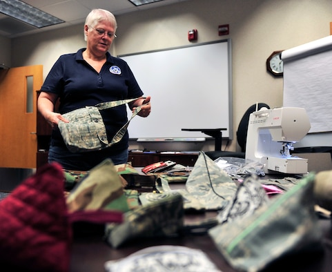 Peggy Beauvais makes purses out of unserviceable, donated uniforms and donates all the proceeds, $400 so far, to the Wounded Warriors program. Beauvais has worked for the military as a civilian employee for more than 28 years now. (U.S. Air Force photo/ Staff Sgt. Stephenie Wade)