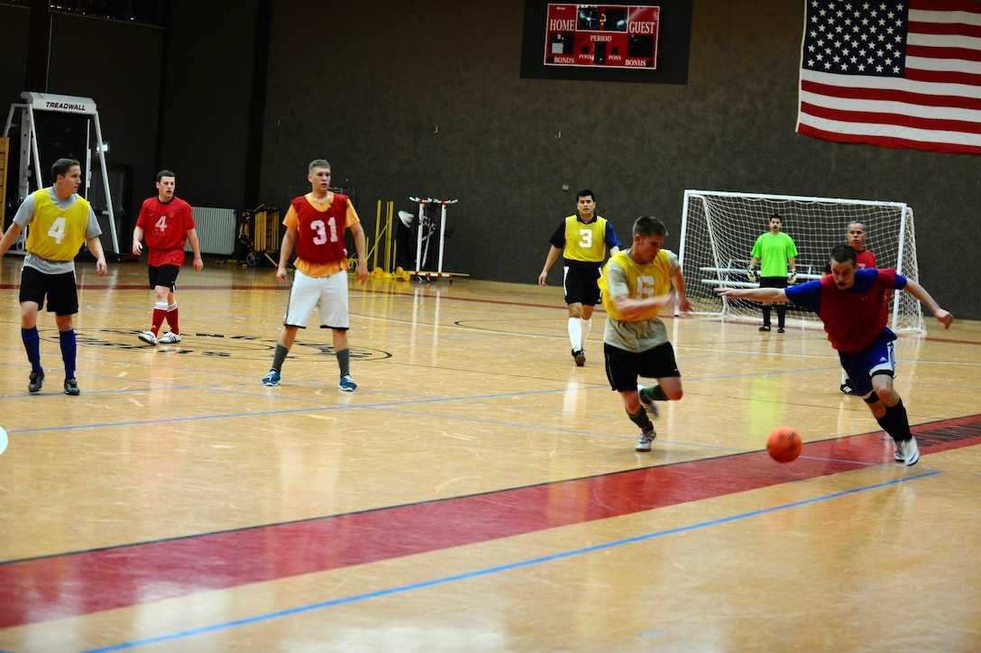 SPANGDAHLEM AIR BASE, Germany – Carl Miller, right, 52nd Force Support Squadron, tries to get past defender Mike Krestyn, 81st Fighter Squadron, during the indoor soccer championship at the Skelton Memorial Fitness Center here June 12. The 52nd FSS defeated the 81st FS in the first game 7-6. The 81st FS won the double-elimination championship after winning the second game 9-5. (U.S. Air Force photo by Airman 1st Class Matthew B. Fredericks/Released)
