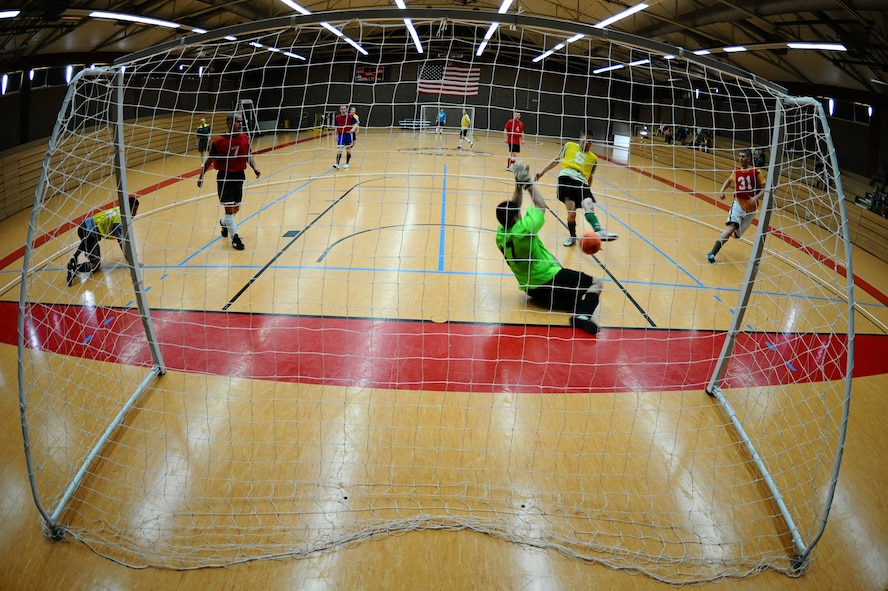 SPANGDAHLEM AIR BASE, Germany – Daniel Gonzales, 52nd Force Support Squadron, attempts to block a shot by Mike Krestyn, 81st Fighter Squadron, during the indoor soccer championship at the Skelton Memorial Fitness Center here June 12. The 52nd FSS defeated the 81st FS in the first game 7-6. The 81st FS won the double-elimination championship after winning the second game 9-5. (U.S. Air Force photo by Airman 1st Class Matthew B. Fredericks/Released)