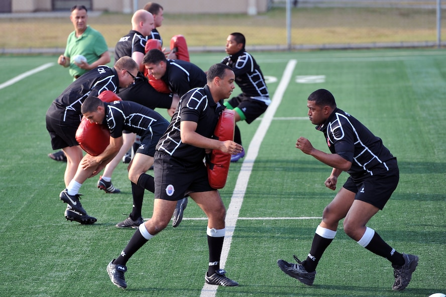 The Osan Exiles rugby team runs drills during a practice at Osan Air Base, Republic of Korea, June 14, 2012. The Exiles compete in the U.S. Forces Korea rugby league and travel the peninsula to play. Players  include members from all military branches. (U.S. Air Force photo/Staff Sgt. Craig Cisek)