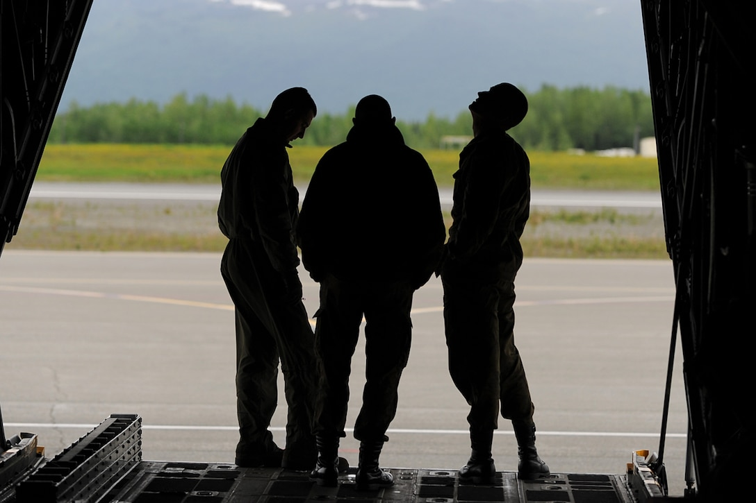 Members of the Polish Air Force C-130 Hercules crew inspect the aircraft during Red Flag-Alaska on Joint Base Elmendorf-Richardson June 13, 2012. The goal of Red Flag-Alaska is to provide each aircrew with vital first missions to increase their chances of survival in combat environments. (U.S. Air Force photo/Airman 1st Class Austin Willhoit)