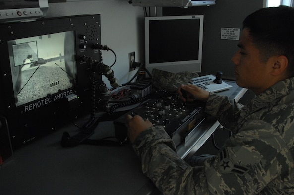 U.S. Air Force Airman 1st Class Gabriel Kalohelani, 366th Civil Engineer Squadron explosive ordnance disposal apprentice, remotely manipulates the controls of an Andros F-6 robot June 13, 2012, at Mountain Home Air Force Base, Idaho. Members of EOD use the robot in extremely dangerous situations when sending in an Airman is not an option. (U.S. Air Force photo by Senior Airman Benjamin Sutton/Released)