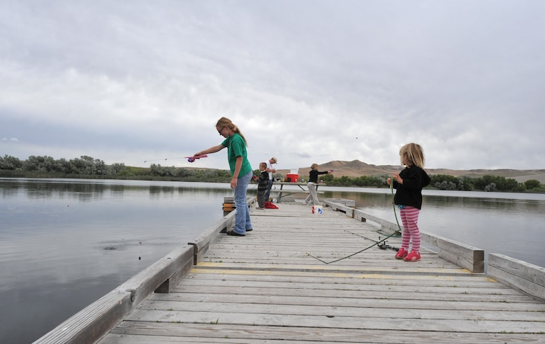 The Lowe family fishes off a dock at Bruneau Dunes State Park, Idaho, June 7, 2012. The family, from Kuna, Idaho, went to the park for a family fun day, starting with climbing the dunes followed by fishing and a picnic. (U.S. Air Force photo/Airman 1st Class Heather Hayward)