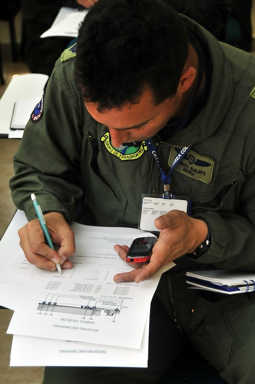 Técnico Subjefe Hector Sierra, Colombian air force member, completes the center of balance handout during a seminar June 6 at Commando Aéreo de Transporte Militar, Bogota, Colombia.  (U.S. Air Force photo by Tech. Sgt. Lesley Waters)