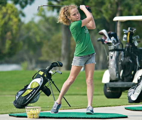 Kari Petersen works on her swing at the driving range during the annual Junior Golf Clinic June 13, at Joint Base San Antonio-Randolph, Texas. (U.S. Air Force photo by Benjamin Faske)